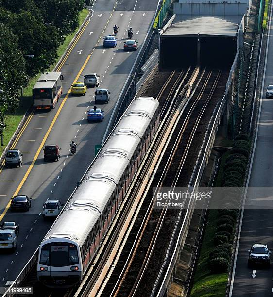 An SMRT Corp train emerges from an underground tunnel in Singapore on Friday May 18 2012 SMRT is the country's biggest subway operator Photographer...