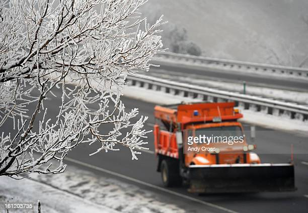 An snowplow makes it's way up westbound I-70 near the Lookout Mountain exit Tuesday morning in fog conditions. Andy Cross, The Denver Post