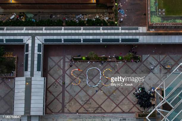 An SOS sign left by protesters is displayed at the campus of Hong Kong Polytechnic University in the Hung Hom district on November 21, 2019 in Hong...