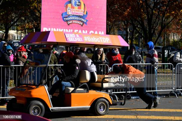 An sponsors' electric golf cart with an empty battery is pushed during the 99th 6ABC/Dunkin' Donuts Annual Thanksgiving Day parade in Philadelphia PA...