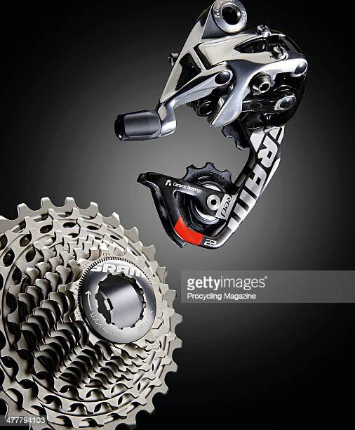 An SRAM RED 22 cassette and rear derailleur photographed on a black background, taken on June 14, 2013.