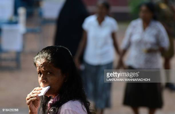 An Sri Lankan voter holds a polling cards to cast their vote at a polling station in Colombo on February 10 2018 The poll to elect 340 local...