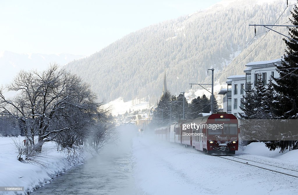 An SSB AG train travels through the town of Davos, Switzerland, on Friday, Jan. 18, 2013. Next week the business elite gather in the Swiss Alps for the 43rd annual meeting of the World Economic Forum in Davos, the five day event runs from Jan. 23-27. Photographer: Chris Ratcliffe/Bloomberg via Getty Images