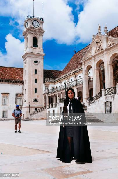 An student member of Tuna or Estudiantina musical group made up of university students posing at University of Coimbra