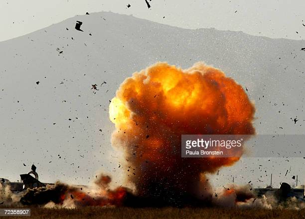 An SU-21 Russian Fitter aircraft is blown up with explosives by the British Royal Air Force Bomb disposal squadron February 11, 2002 at Kabul...