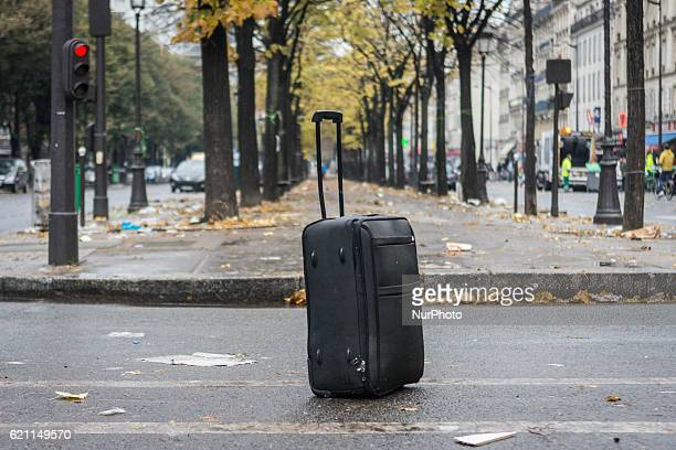 An suitcase abandoned during the evacuation of a makeshift camp near Stalingrad metro station in Paris on November 4 one of several camps sprouting...