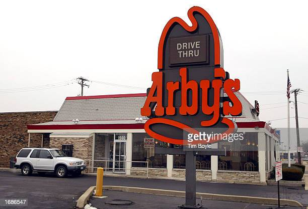 An SUV sits at the pickup window of an Arby's restaurant December 13 2002 in Des Plaines Illinois Owner Diageo PLC the world's largest liquor company...