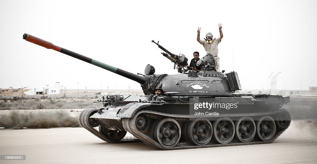 An T55 tank commandeered by NTC fighters moves at speed towards the airport of Colonel Gaddafi's home city of Sirte on October 06, 2011 in Libya. NTC forces are continuing their advance on Colonel Muammar Gaddafi's hometown of Sirte.