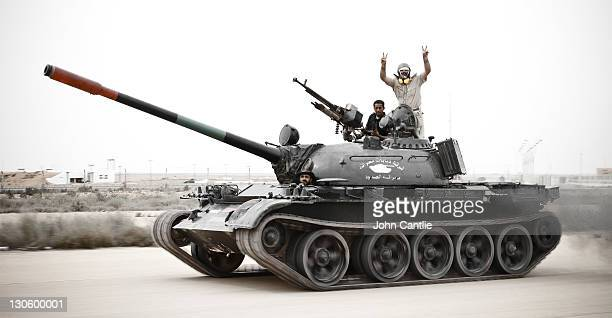 An T55 tank commandeered by NTC fighters moves at speed towards the airport of Colonel Gaddafi's home city of Sirte on October 06 2011 in Libya NTC...