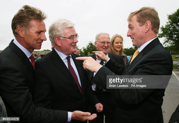 An Taoiseach Enda Kenny with Tanaiste Eamon Gilmore and Fine Gael local election candidate Eamonn Coghlan at the launch of Construction 2020 a...