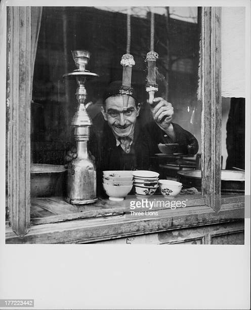 An tea shop, also selling the use of water pipes and opium pipes, Iran, circa 1930-1960.