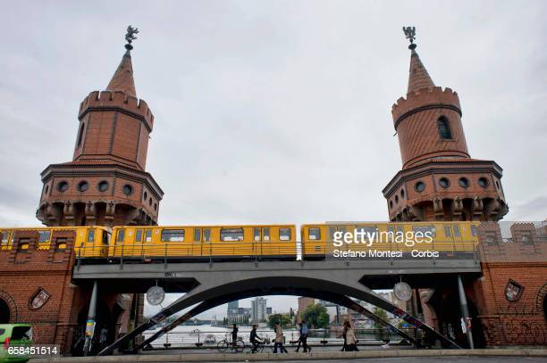 "An UBahn train crosses the Oberbaum Bridge light installation Rock Paper Scissors"" by Thorsten Goldberg The Oberbaum Bridge is a doubledeck bridge..."