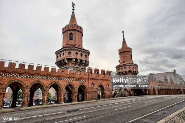 An UBahn train crosses the Oberbaum Bridge The Oberbaum Bridge is a doubledeck bridge crossing Berlin's River Spree considered one of the city...