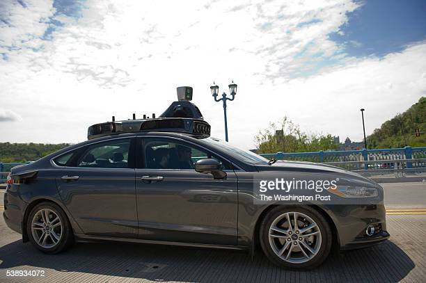 An Uber automatedvehicle taking a testdrive on the 31st Street Bridge The company has moved engineers and leased land throughout the Pittsburgh...