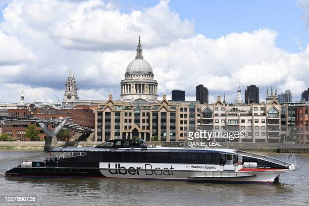 An Uber boat passes St Paul's cathedral in partnership with Thames clippers the boat tickets can be purchased via the ride hailing firm's app on...