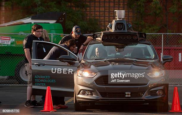 An Uber driverless Ford Fusion sits in the Uber Technical Center parking lot on September 2016 in Pittsburgh Pennsylvania Uber has built its Uber...
