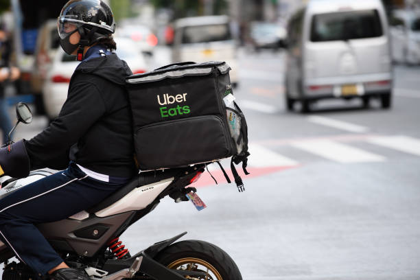 JPN: Uber Japan Couriers As Olympic Games Boost Foot-delivery Operators