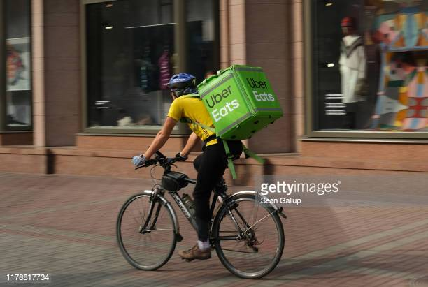 An Uber Eats food courier rides in the city center on October 03, 2019 in Kiev, Ukraine. Uber has established itself firmly in Kiev and is now facing...