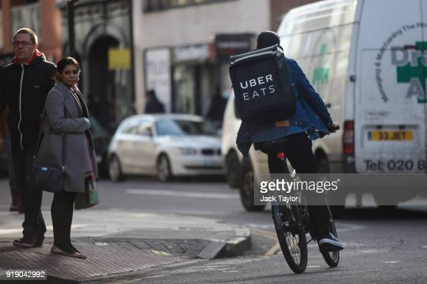 An Uber Eats rider cycles through central London on February 16 2018 in London England Millions of parttime and flexible workers in the socalled gig...