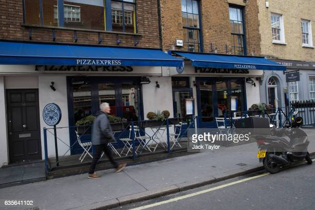 An Uber Eats scooter is parked outside a Pizza Express restaurant in Marylebone on February 16 2017 in London England The Association for Licensed...