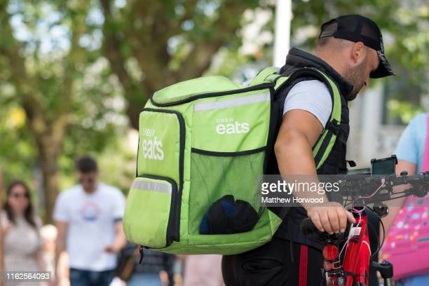 An Uber Eats worker walks his bike through Cardiff city centre on July 7 2019 in Cardiff United Kingdom