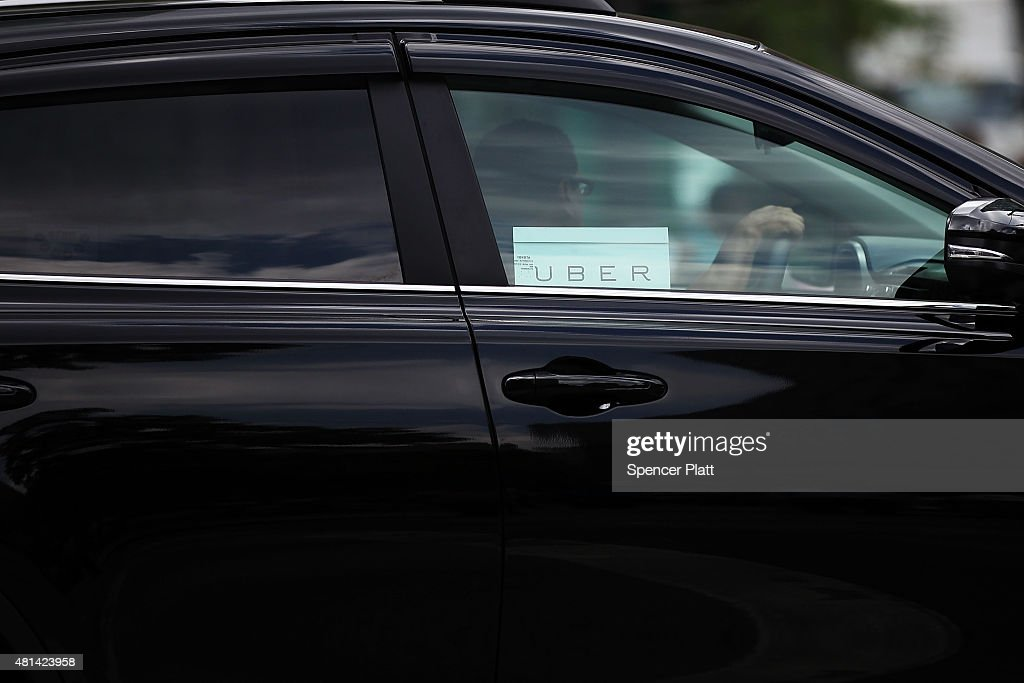 An Uber vehicle is viewed in Manhattan on July 20, 2015 in New York City. New York's City Council has proposed two bills last month to limit the number of new for-hire vehicles, as well as to study the rapidly rising industry's impact on traffic. Uber has responded in an open letter arguing that its 6,000 Uber cars out during an average hour are a small part of the city's overall traffic. In cities across the globe Uber has upended the traditional taxi concept with many drivers and governments taking action against the California based company.