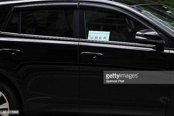 An Uber vehicle is viewed in Manhattan on July 20 2015 in New York City New York's City Council has proposed two bills last month to limit the number...