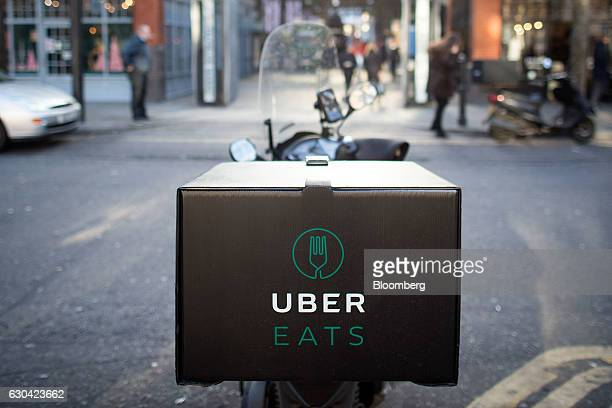 An UberEats operated by Uber Technologies Inc branded box sits on a motor scooter in London UK on Thursday Dec 22 2016 The food delivery business...