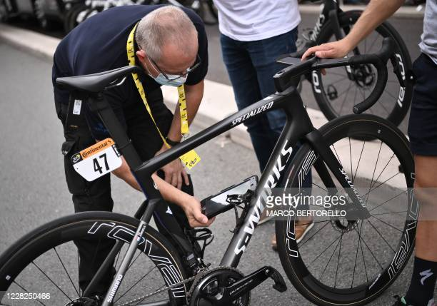 An UCI inspector checks a frame for hidden engines prior to the 1st stage of the 107th edition of the Tour de France cycling race, 156 km between...