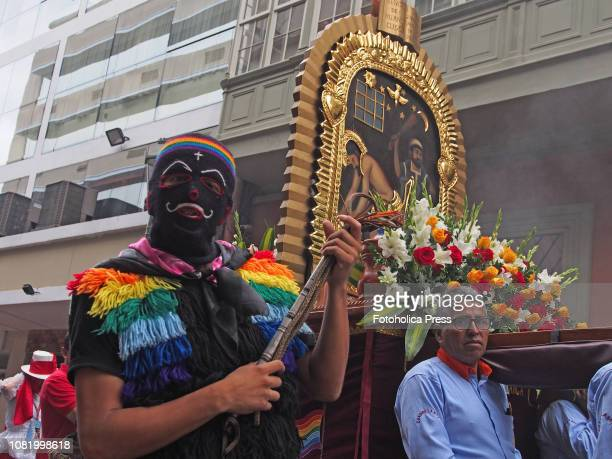 An 'Ucucu' wool masked man mixture of buffoon and guard dances plays and places order with his whip in the procession when hundreds of...