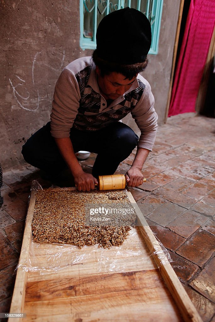 An Uighur man is in the production of traditional nut cake in Kashgar, on December 10, 2012 in Kashi, China. Kashgar is home to the ethnic Uyghur Muslim community.