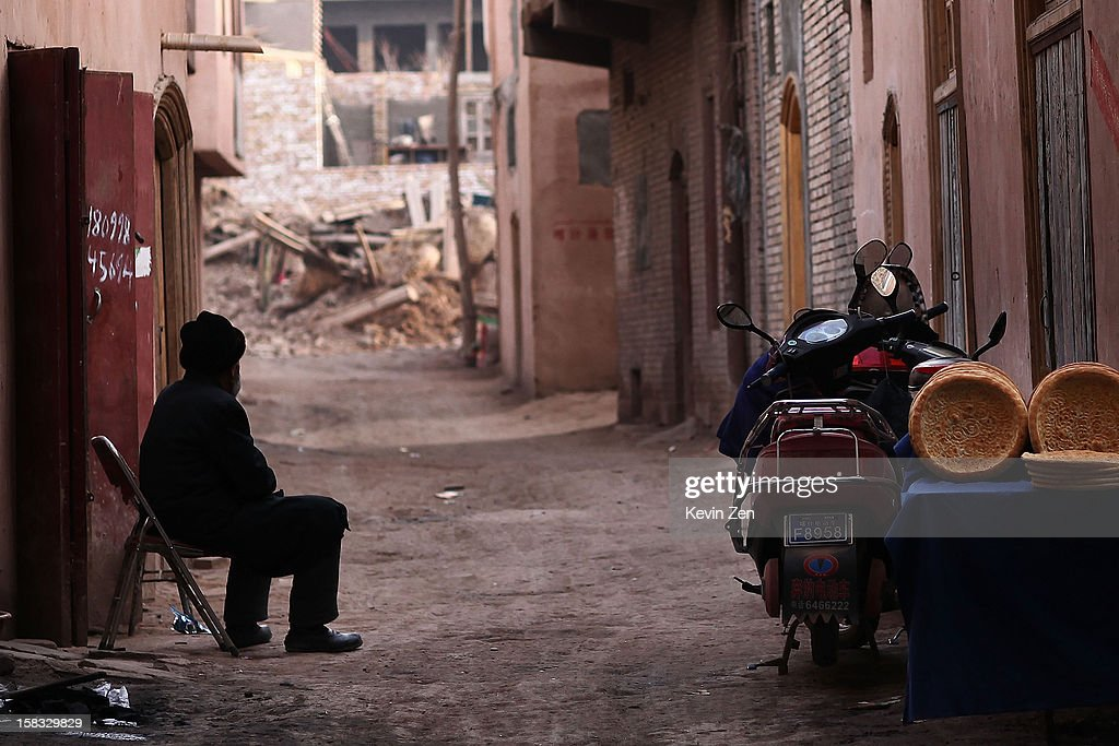An Uighur man on the street sits waiting for the customers in Kashgar, on December 10, 2012 in Kashi, China. Kashgar is home to the ethnic Uyghur Muslim community.