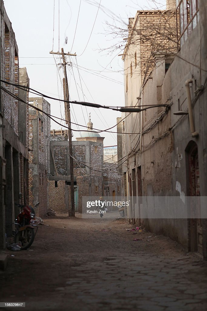 An Uighur woman walks by the old street in Kashgar, on December 10, 2012 in Kashi, China. Kashgar is home to the ethnic Uyghur Muslim community.