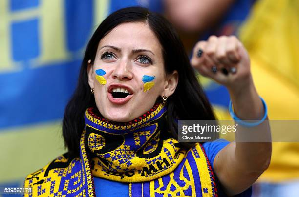 An Ukraine fan enjoys the atmosphere prior to the UEFA EURO 2016 Group C match between Germany and Ukraine at Stade PierreMauroy on June 12 2016 in...