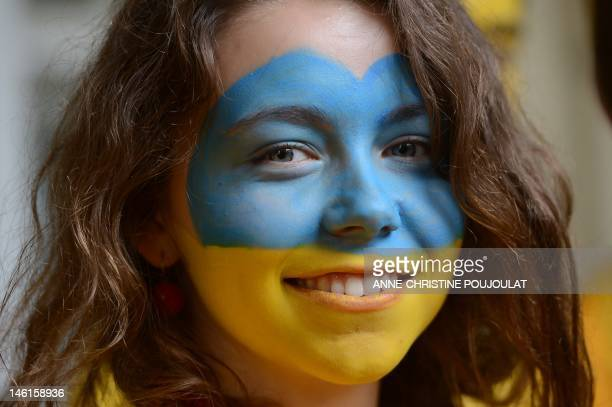 An Ukrainian football fans poses on June 11 2012 in Lviv before the Euro 2012 football match UkraineSweden AFP PHOTO / ANNECHRISTINE POUJOULAT