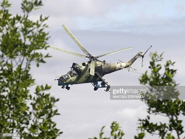 An Ukrainian MI24 helicopter flies near the eastern Ukrainian city of Kramatorsk on August 19 2014 Ukraine accused proRussian rebels of killing...