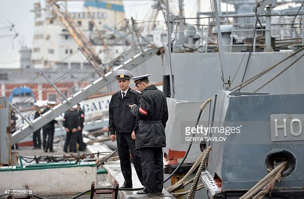 An Ukrainian sailors stand next to their warships in southern Ukrainian city Odessa on May 3, 2015. Fighting between pro-Russian rebels and the...
