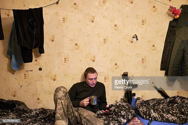 An Ukrainian serviceman rests and has a drink in a room in the frontline city of Avdiivka as Ukrainian forces pushed back an attack by proRussian...