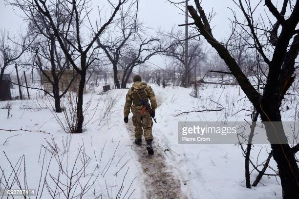 An Ukrainian soldier walks to a frontline position as fighting between Ukrainian forces and Russiabacked forces resumed on the frontline on the...