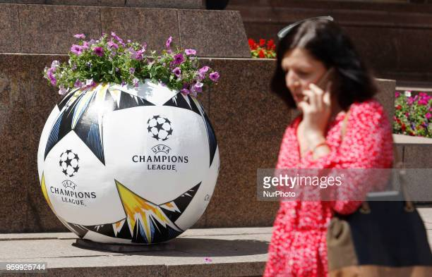 An Ukrainian woman walks past a flower bed with the logo the UEFA Champions League final in central Kiev Ukraine 18 May 2018 The football UEFA...