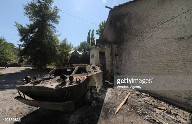 An Ukranian tank is destroyed by proRussian separatists during the clashes between Ukranian army in Donetsk Ukraine on 28 July 2014 Ukranian army...