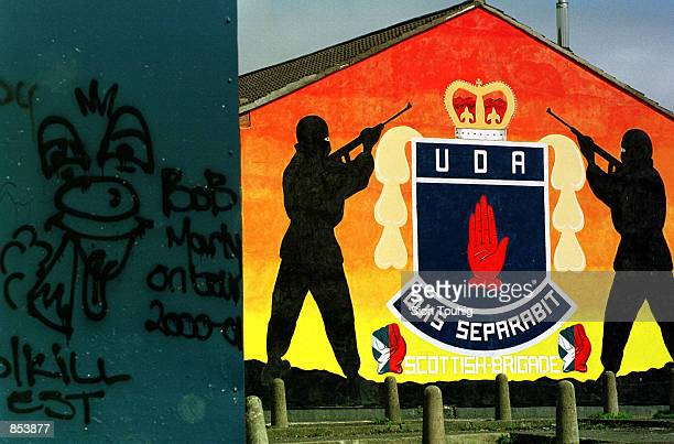 An Ulster Defence Association Loyalist mural is painted on the side of a building April 16 2001 in an Protestant Loyalist neighborhood on the Lower...