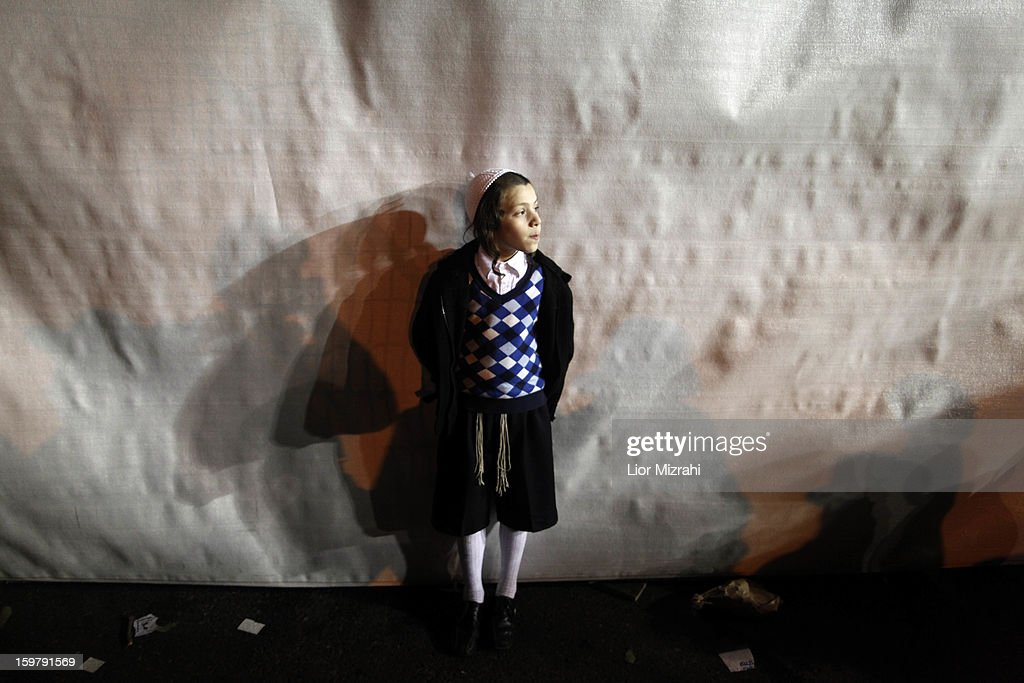 An Ultra Orthodox Jewish child stands during an anti-election rally on January 20, 2013 in Jerusalem, Israel. The Israeli general election will be held on January 22.