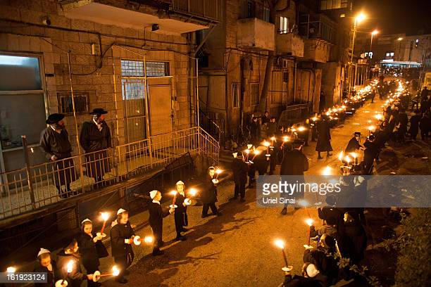 An Ultra Orthodox Jewish children of the UltraOrthodox Tholdot Avraham Yizhak Hasidic dynasty march with torches during an inauguration ceremony for...