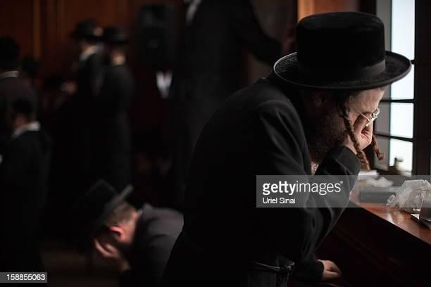 An Ultra Orthodox Jewish man cries at the funeral of Rabbi Abraham Jacob Friedman of Sadigura Hasidic dynasty on January 01 2013 in Bnei Brak Israel...
