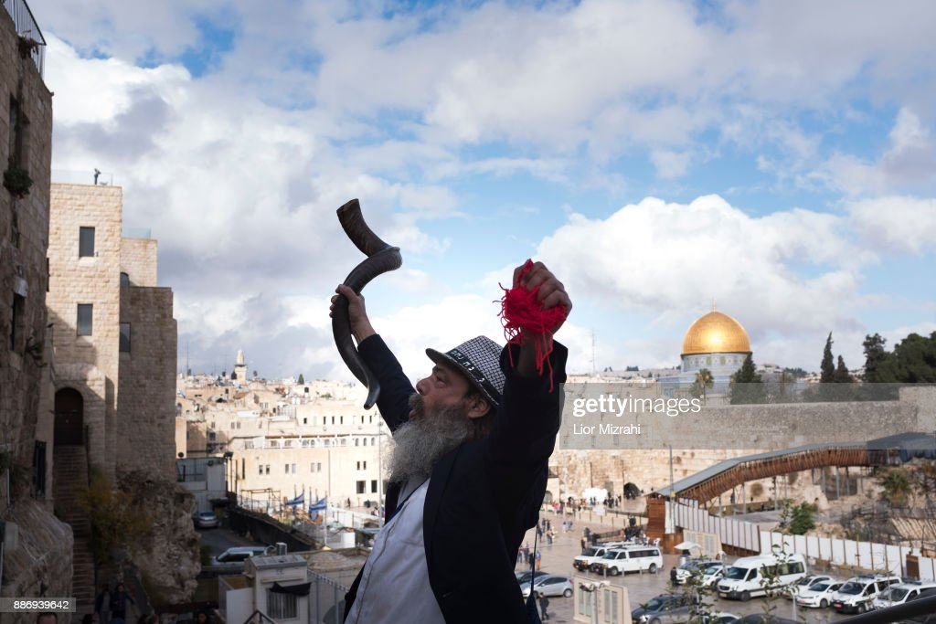An Ultra Orthodox Jewish man holds a shofar (ram's horn) with the golden Dome of the Rock Islamic shrine behind on December 6, 2017 in Jerusalem, Israel. U.S. President Donald Trump will announce his recognition of Jerusalem as Israel's capital on Wednesday.