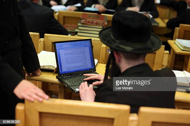 An Ultra Orthodox Jewish man study with laptop in Belz synagogue on April 14 2011 in Jerusalem Israel