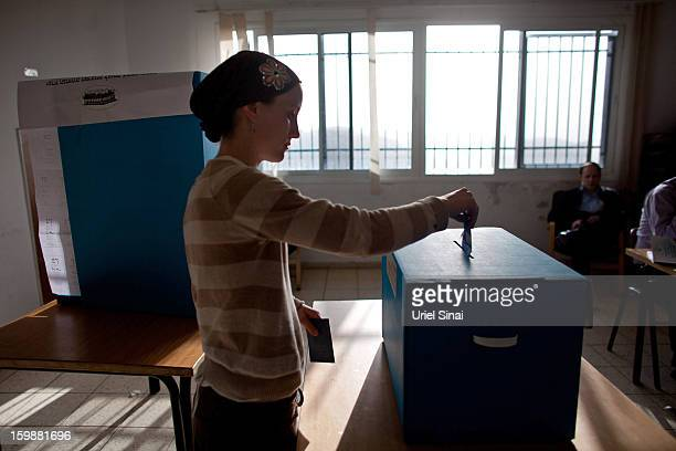 An Ultra Orthodox Jewish woman casts her vote at a polling station on January 22 2013 in Kiryat Ye'arim Israel The latest opinion polls suggest that...
