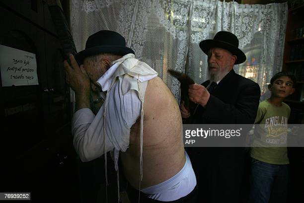 An Ultra Orthodox Rabi David Nisnof of the Bokharan Jewish community whips a man with leather straps as a symbolic punishment for his sins during the...