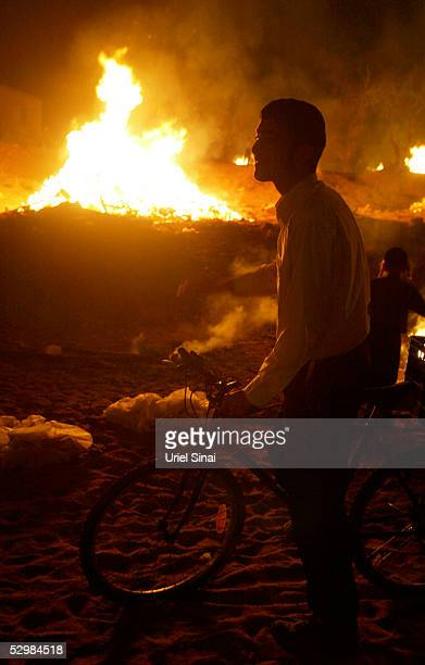 An Ultra Ortodox Israeli is silhouetted by a bonfire during Lag BaOmer festivities May 26 2005 in Bnei Brak Israel Israelis celebrate the Jewish...